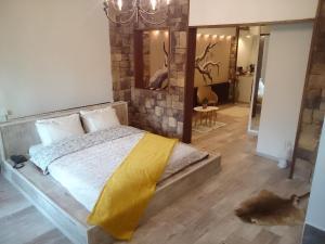 Ένα ή περισσότερα κρεβάτια σε δωμάτιο στο Όαση