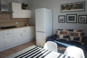 A kitchen or kitchenette at Astoria Club
