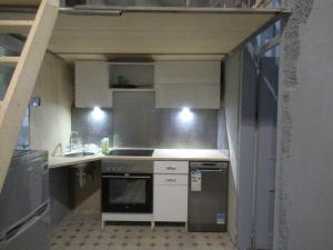A kitchen or kitchenette at Apartamenty Bagatela 14