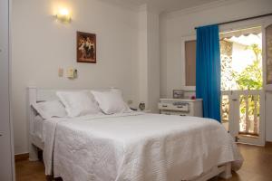 Un ou plusieurs lits dans un hébergement de l'établissement Casa Villa Colonial By Akel Hotels