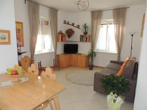 A seating area at Appartamenti Casa Prandel