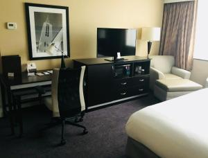 A television and/or entertainment center at The Strathallan - a DoubleTree by Hilton