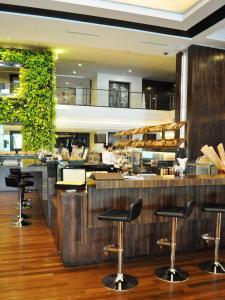 مطعم أو مكان آخر لتناول الطعام في فندق جي تاور