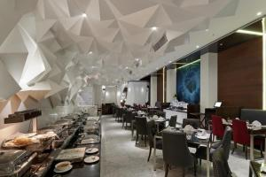 A restaurant or other place to eat at The Elanza Hotel, Bangalore
