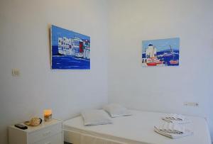 Ein Bett oder Betten in einem Zimmer der Unterkunft Economy Studios by Voula