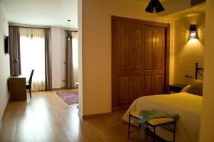 A bed or beds in a room at Estrella de las Nieves