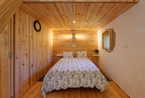 A bed or beds in a room at Renovated farm house with relaxing sun deck
