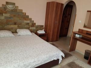 Кровать или кровати в номере Olympia