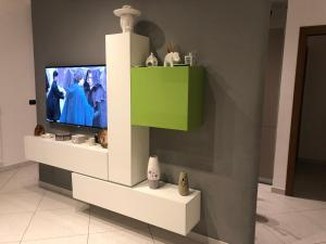 A television and/or entertainment center at Appartamento Flagaia