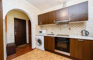 Кухня или мини-кухня в Апартаменты «У моря»