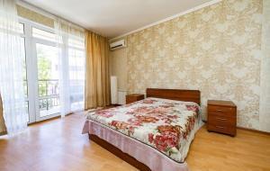 Кровать или кровати в номере Апартаменты «У моря»