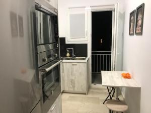 A kitchen or kitchenette at Renovated minimal apartment next to metro