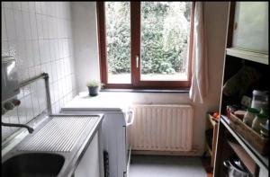 A kitchen or kitchenette at Chez Mimi - chambre vue parc