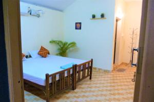 A bed or beds in a room at The Lungi Vibe