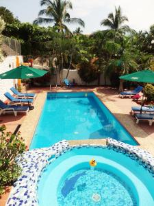 The swimming pool at or near Hotelito Swiss Oasis - Solo Adultos