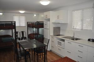 A kitchen or kitchenette at BIG4 MacDonnell Range Holiday Park