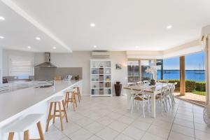 A kitchen or kitchenette at Delphini 1 - Salamander Bay