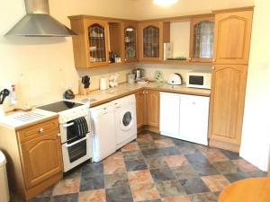 A kitchen or kitchenette at Hewenden Mill Apartments