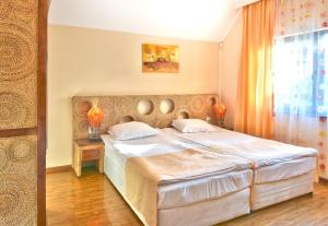A bed or beds in a room at Topola Skies Resort & Aquapark - All Inclusive