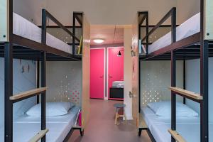 A bunk bed or bunk beds in a room at Stayokay Amsterdam Oost