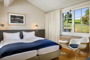 Ein Bett oder Betten in einem Zimmer der Unterkunft Hotel Wassberg