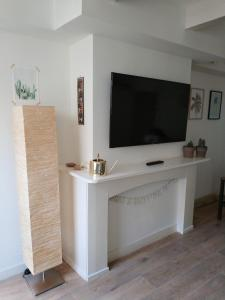 A television and/or entertainment center at Fruit of the City - R.Q.C.