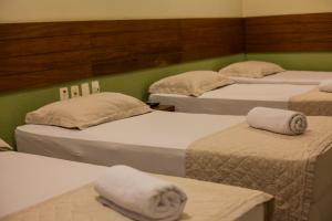 A bed or beds in a room at Portal Da Praia Hotel