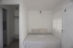 A bed or beds in a room at Mandala Apt 2 Maracajaú