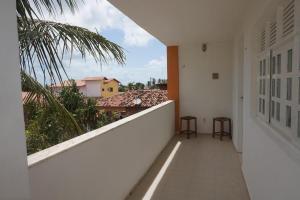 A balcony or terrace at Mandala Apt 2 Maracajaú