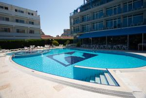The swimming pool at or near Regata Palace - All Inclusive