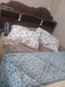 A bed or beds in a room at Pousada Bela Vista
