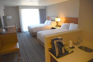 A bed or beds in a room at Doubletree By Hilton Helena Downtown
