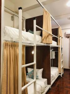 A bunk bed or bunk beds in a room at Sanga Hostel