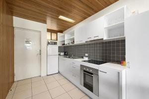 A kitchen or kitchenette at The Beachcomber