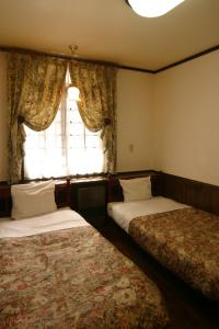 A bed or beds in a room at Pension Waltz