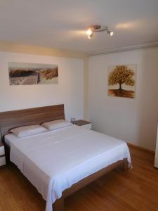 A bed or beds in a room at Villa Marija