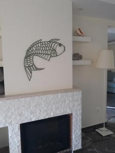 A television and/or entertainment centre at Vouliagmeni Sea and Sun Apartment
