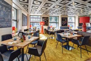 Ein Restaurant oder anderes Speiselokal in der Unterkunft Cascada Boutique Hotel