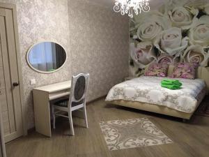A bed or beds in a room at гостевой дом на совхозной 10а