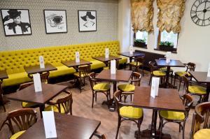 Un restaurant sau alt loc unde se poate mânca la Hotel Capitolina City Chic