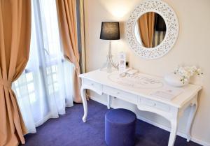O baie la Hotel Capitolina City Chic