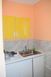 A kitchen or kitchenette at The One Apartments #Studio 2