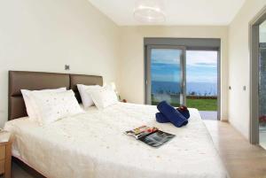 Ein Bett oder Betten in einem Zimmer der Unterkunft Trapezaki Bay View