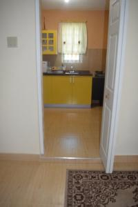 A kitchen or kitchenette at The One Apartments #Studio 3