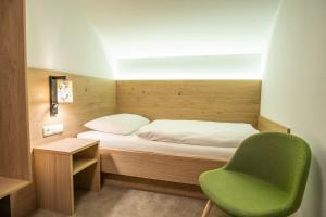 Ein Bett oder Betten in einem Zimmer der Unterkunft Hotel & Chalet Bellevue