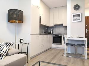 A kitchen or kitchenette at Hestia Apartments Chopin Airport Deluxe