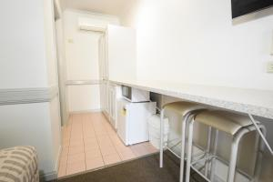 A kitchen or kitchenette at Centretown Motel