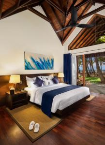 A bed or beds in a room at Ayana Sea