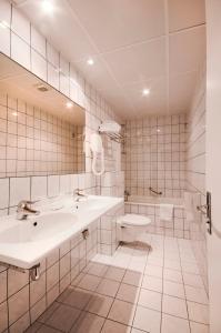 Ванная комната в Hotel Peyris Opera