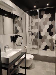 Łazienka w obiekcie H33 Apartamenty
